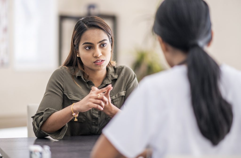 image of counsellor talking to patient